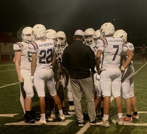 PHS JV football team takes a timeout to reset play.