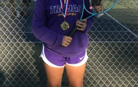 Grace Laramore finishing third in number five singles with her medal