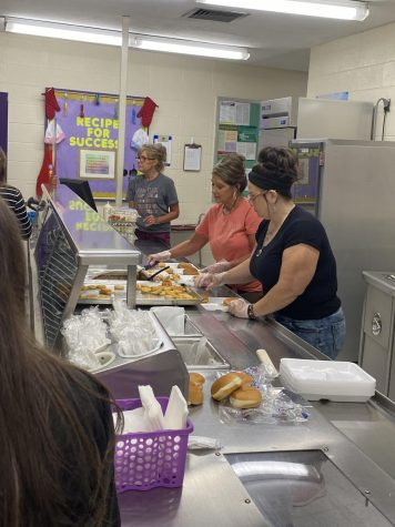 Lunch Ladies serving fourth Lunch Shift